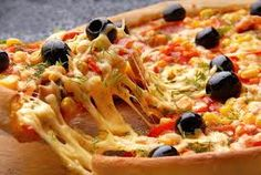 Pizza covered with olive , corns , green chillies with melted cheese.