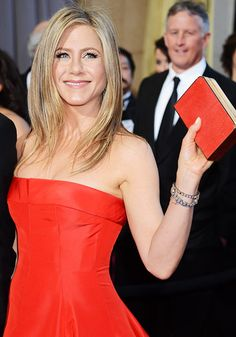Jennifer Aniston waved in a red strapless Valentino gown for the 85th Annual Academy Awards in Los Angeles Feb. 24.