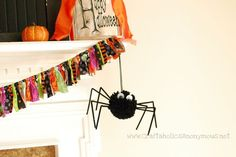 Make this fuzzy black pom pom spider with an old t-shirt! Scarily cute spider craft! Perfect for halloween craft idea! includes tutorial