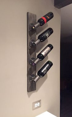 Add your favorite wines to this custom handmade pipe wine rack. Complimenting both modern and vintage decor, this industrial styled wine rack is custom stained and made with cleaned, sanded and polyd piping. Various woods colors available upon request. Dimensions: L: 4 W: 4-1/4 H: 32-1/4