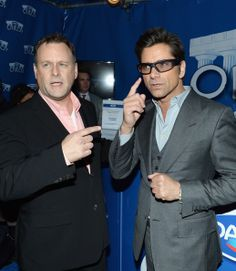 (L-R) Dave Coulier and John Stamos show the lighter side of the game with Dannon Oikos on January 29, 2014 in New York City. Wearing Durango Smokes.
