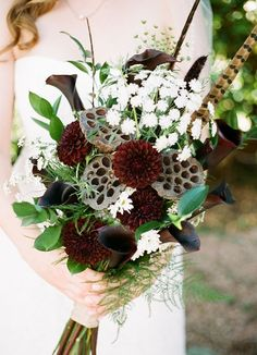 20 Wedding Bouquets with Feather Details | SouthBound Bride | http://www.southboundbride.com/20-wedding-bouquets-with-feather-details | Credit: Gaby J Photography/Keri Macanas/Albertsons via Oh Lovely Day