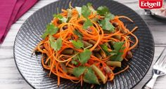 Fresh and crunchy carrot and pistachio salad, tossed with a zesty vinaigrette.   #summersalad #vegetarian #lunch #easyrecipe