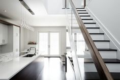 Decor Interior. Captivating Contemporary Interior Design. Contemporary Kitchen Interior Design Include Dark Wood Kitchen Island With White Counter Top And Simple Wooden Staircase With Glass Railing And Wooden Handling. Contemporary Interiors