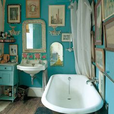 I love this bathroom: the colour of the walls, the old pictures and fittings, and especially the roll-top bath.