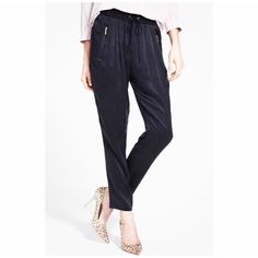 PAIGE Black Pants Black pants with front zip pockets. Elastic waistband and drawstring. Cropped tapered leg. 100% Polyester. Worn once. Paige Jeans Pants Ankle & Cropped