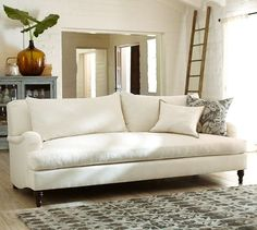Carlisle Upholstered Sofa | Pottery Barn | Love the classic rolled arm and the bench cushion. They have performance fabrics.