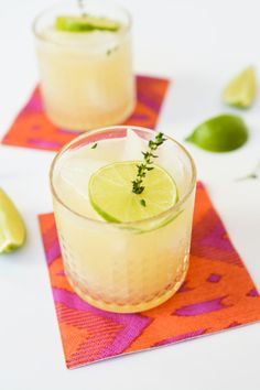 Pear cocktail with wine, fresh thyme and lime juice.
