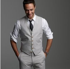 For the groomsmen, they can wear a white button up (sleeves rolled up) and grey slacks, while Micah can wear that along with a vest. Maybe a blue tie instead.