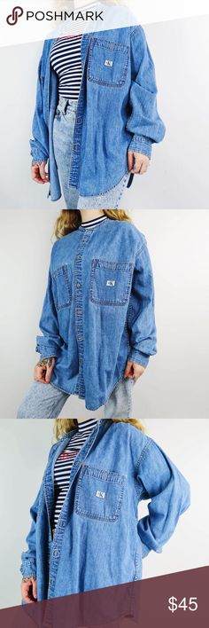 VTG Unisex Calvin Klein Jeans Denim ButtonUp Shirt Vintage 90s Calvin Klein Jeans denim button up Longsleeve shirt. Unisex size large. Definitely a good look for the fall. Great vintage condition, no notable flaws. Calvin Klein Tops Button Down Shirts