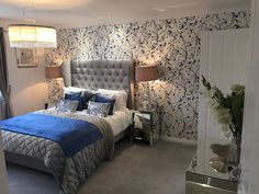 Blue and grey bedroom feature wallpaper fabric headboard grey carpet
