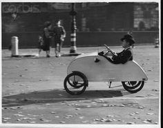 A motorist drives his tiny 'Velocar', with 'double pedal' movement, through Hyde Park in answer to gasoline rationing during World War II.