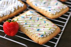 Homemade Pop Tarts Dough:     1 1/3c Oat Flour (+ 1/2c, rolling)     1c Brown Rice Flour     2T Ground Flaxseed     3/4t Salt     3/4c Palm Shortening*, soft     1/3c Agave Nectar     1t Butter extract Filling:     10T 100% Fruit Spread (strawberry or blackberry) Icing:     1/2c Powdered Erythritol     1T Unsweetened Almond Milk     1t Vanilla Homemade Rainbow Sprinkles