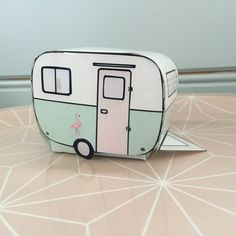 Print your own paper caravan / trailer!  Cosy caravan with cactus and flowers behind the window and colorful bunting and a flamingo.  For decoration or as a gift box/ favor box ( simply put the caravan over your box- also in the file)  Print out on your home printer. For a nice result use glossy photo paper.  Cut, fold and tape or glue together. I prefer tape;-)  Nice to use as a paper toy or as home decoration. But also nice to hide treats such as candy or chips..    You receive a ...
