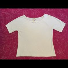 Talbots short sleeve white stretchy top. Talbots new white stretchy top. Perfect for spring. Short sleeved but sleeves are a little longer. Great alone or under jackets, tops or dresses. Size Large. *shown under Talbots dress in my closet. Talbots Tops