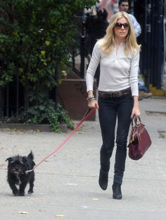 Sienna miller. black jeans, leather belt and casual cotton top, Dressed up with boots and leather bag