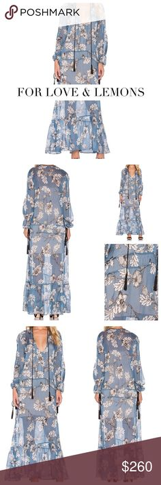 """NWT-FOR LOVE & LEMONS BLUE FLORAL MAXI DRESS For Love and Lemons Santa Rosa Maxi Dress features a flowing silk chiffon fabrication with the brands exclusive hand drawn floral print and tassel trim. Nude slip is included with this fabulous maxi. Imported. Material: 100% Silk Chiffon Size Small (Approx US 6). Approximate Measurements: Bust: 32-36"""", Waist: 25""""-32"""", Hips: 30-38"""" Maxi is designed for a relaxed and carefree fit. Still in Stores. Condition: Pristine: NWT For Love and Lemons Dresses…"""