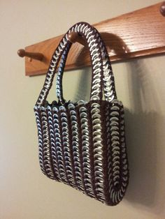 This cute little handbag is crocheted out of pop tabs from soda cans. I found it at a thrift shop recently. After I pull the tans off about a thousand cans I will attempt to create one!