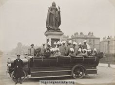 A photograph of the 1914-1918 War. A charabanc load of convalescent Indian soldiers by the Queen Victoria statue in Grand Avenue. Probably they had come from their Hospital quarters in the Royal Pavilion. The bowler hatted civilian at the front was Mr. J. Hutchinson, Traffic Manager of Thomas Tilling Ltd. who then operated motor buses in Brighton and Hove.
