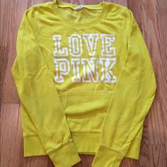 VS Pink Yellow crew neck sweatshirt Size medium. Yellow crew neck sweatshirt. No stains or imperfections. Gently worn couple times! Smoke free home. Offers and trades are welcome! PINK Victoria's Secret Tops
