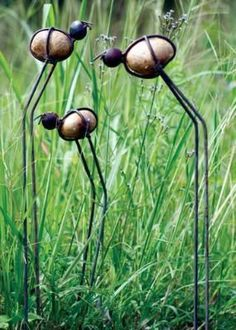 Bohemian Pages: DIY Friday- Garden Tools Re-Vamped Rock and Wire Bugs