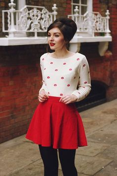 Shop this look on Lookastic:  http://lookastic.com/women/looks/white-and-red-print-crew-neck-sweater-red-skater-skirt-black-wool-tights/7527  — White and Red Print Crew-neck Sweater  — Red Skater Skirt  — Black Wool Tights