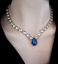 Bridal jewelry - Crystal statement necklace - Made with Swarovski famous sparkling clear crystals - Blue sapphire crystal drop - All handset by