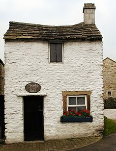 Thimble Hall, a tiny cottage in Youlgrave, Derbyshire is officially the smallest house in the world.  Its miniscule statistics are a mere 11ft 10in by 10ft 3in by 12ft 2in high.