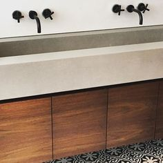 Noe Valley floating master vanity with concrete trough sink. Black fixtures/lime…