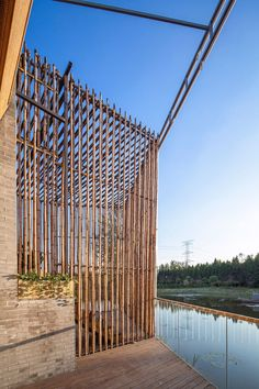 Shanghai-based architectural firm Harmony World Consulting & Design has designed the Bamboo Courtyard House. Completed in 2012, this 4,306 square foot contemporary office in Yangzhou, China, is inspired by traditional Chinese architecture, featuring a courtyard and extensive use of bamboo.                  Photos by: T+E