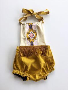 A personal favorite from my Etsy shop https://www.etsy.com/listing/267224606/boho-baby-romper-fringe-romper-aztec