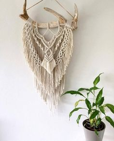 FAWN - A truly unique and beautiful wall-hanging. This macrame wall-hanging is a striking beauty. It is made using a variety of macrame knotting techniques with thick textured fringing and finished with a jute twine cord for hanging. This piece is a modern bohemian inspired dream!