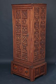 "Fine and substantial single door and drawer wardrobe with layered geometric patterning, the center door panel features the initials ""VJM"", American, late 19th century Height 75"" Wide 32"" Deep 24"""