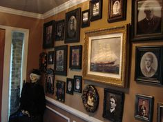 Haunted portrait wall - Gods, I would LOVE to be able to do something like this for Halloween