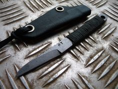 Custom made knives, sheaths and tactical products .