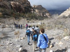 Instead of sidewalks, they trekked along a dirt trail. Instead of climbing stairs, they scrambled over boulders. On Dec. 6, the nonprofit Las Vegas Inspiring Connections Outdoors took a group of students who previously knew only city life on a hike in Red Rock Canyon National Conservation.