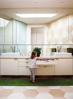 Hexagonal tilesmade by the Portland Cement Company clad the walls and floor in a Portland, Oregon, bathroom.    This originally appeared in 28 Triangles Make Up This Hyper-Angular Family Home.