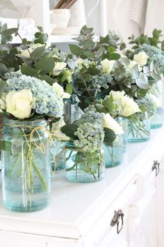 Upcycle those blue mason jars you have in the pantry by filling with hydrangeas (this is Wedding Ring in acid soil) and a few white roses. Add texture (and fragrance) with sprigs of eucalyptus.