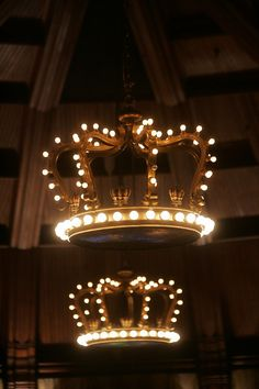 antique giant wood crown chandeliers at the haunted hotel del cornado in san diego