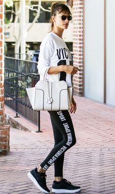 alessandra ambrosio wearing leggings and black sneakers