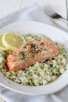 Salmon and Lemon Herb Cauliflower Rice - the Whole Smiths Whole30 Fish Recipes, Seafood Recipes, Paleo Recipes, Chicken Recipes, Paleo Meals, Pan Fried Salmon, Roasted Salmon, Baked Salmon, Cauliflower Recipes