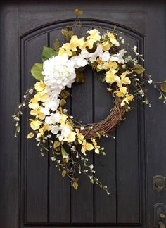 An original design by An Extraordinary Gift © I started with an 18 grapevine base. I then added peony branches for a natural feel, wispy white floral branches, yellow and white blooms and a white hydrangea to tie it all together. Love this combination! This design measures