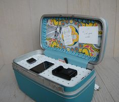 DIY old suitcase into charging station.  cord chaos solved!