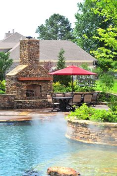 A poolside fireplace and dining area creates the perfect spot to entertain family and friends. J. Brownlee Pool  Landscape; Photography by Terry Sweeney http://www.poolspaoutdoor.com/pools/inground-pools/articles/ultimate-home-resort.aspx
