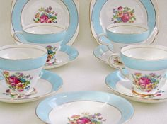 Teacups, sauchers and small plates. English Bone China Blue Band Rose 1940s by http://BonAppetitAntique.etsy.com
