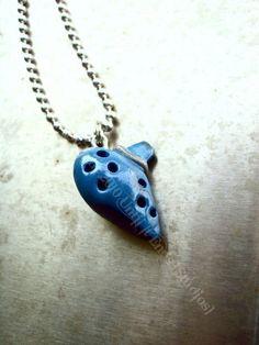 Legend Of Zelda Ocarina Charm Necklace. $8.99, via Etsy.