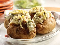 Asparagus, ham and cheese are a classic combination...here that combo tops hot baked potatoes to make a quick-cooking, comforting dish.