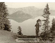 This view by Edward Curtis shows a Klamath chief in a ceremonial headdress looking out across Crater Lake, in the western end of the Klamath territory. The current Klamath Tribe includes the Klamath, Modoc and Yakooskin peoples of southwest Oregon and northern California. At their termination of 1954, the Klamath tribe was the second wealthiest tribe in the United States.: