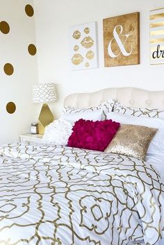 Gold embellished quatrefoil bedding looks right at home with the gold wall art and polka-dot wall!