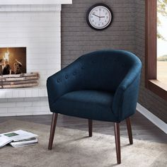 Get a sleek, yet casual modern look with the Camilla accent chair. Upholstered in a beautiful navy fabric, this chair is complete with long espresso finished legs.